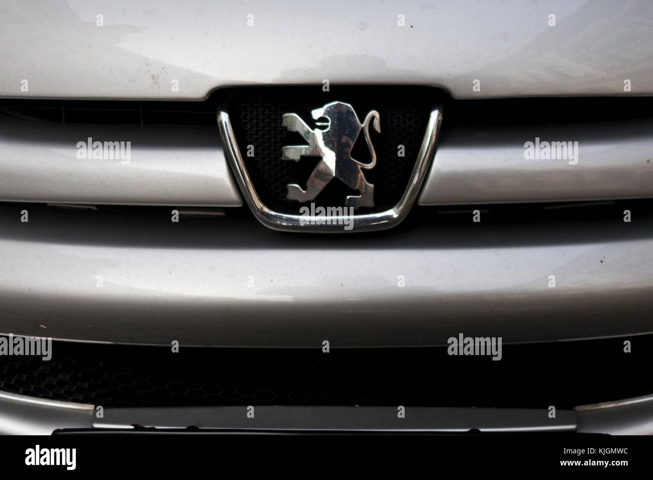 Peugeot logo on a car grille - Stock Image