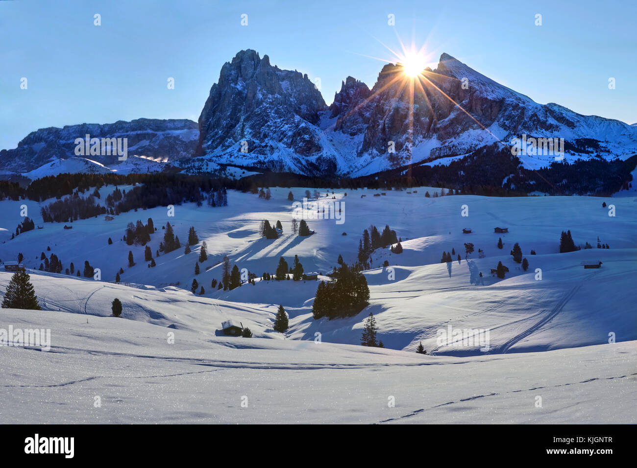 Winter sunrise over Alpe di Siusi with view on Sassolungo and Sassopiatto, Dolomites, Italy - Stock Image