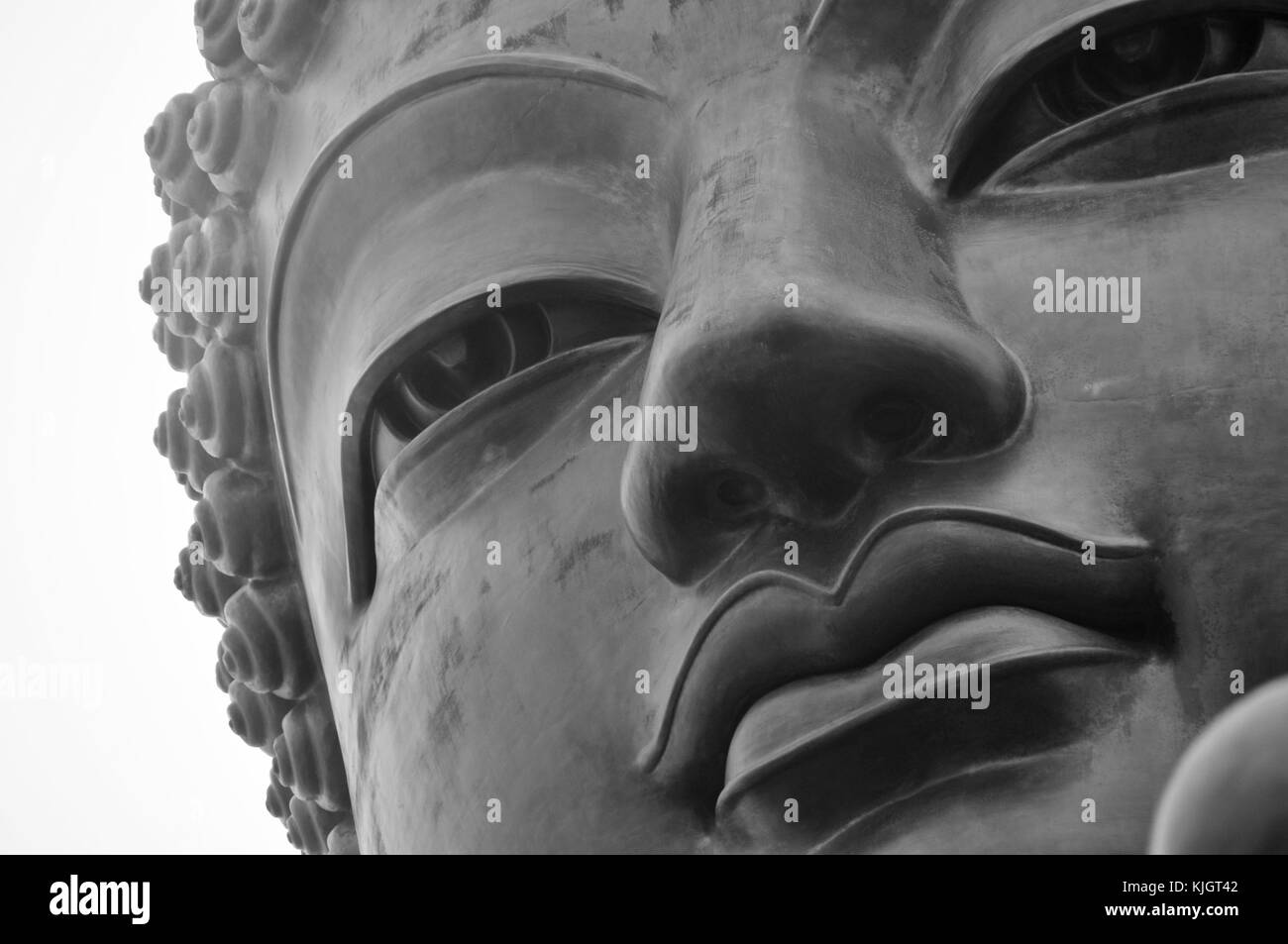 Tian Tan Buddha of Hong Kong shrouded in fog. - Stock Image
