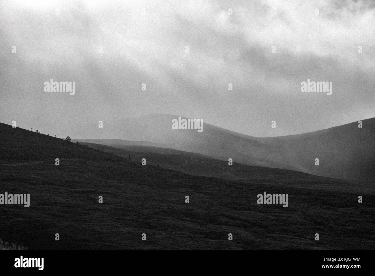Black and white grainy mountain landscape - Stock Image