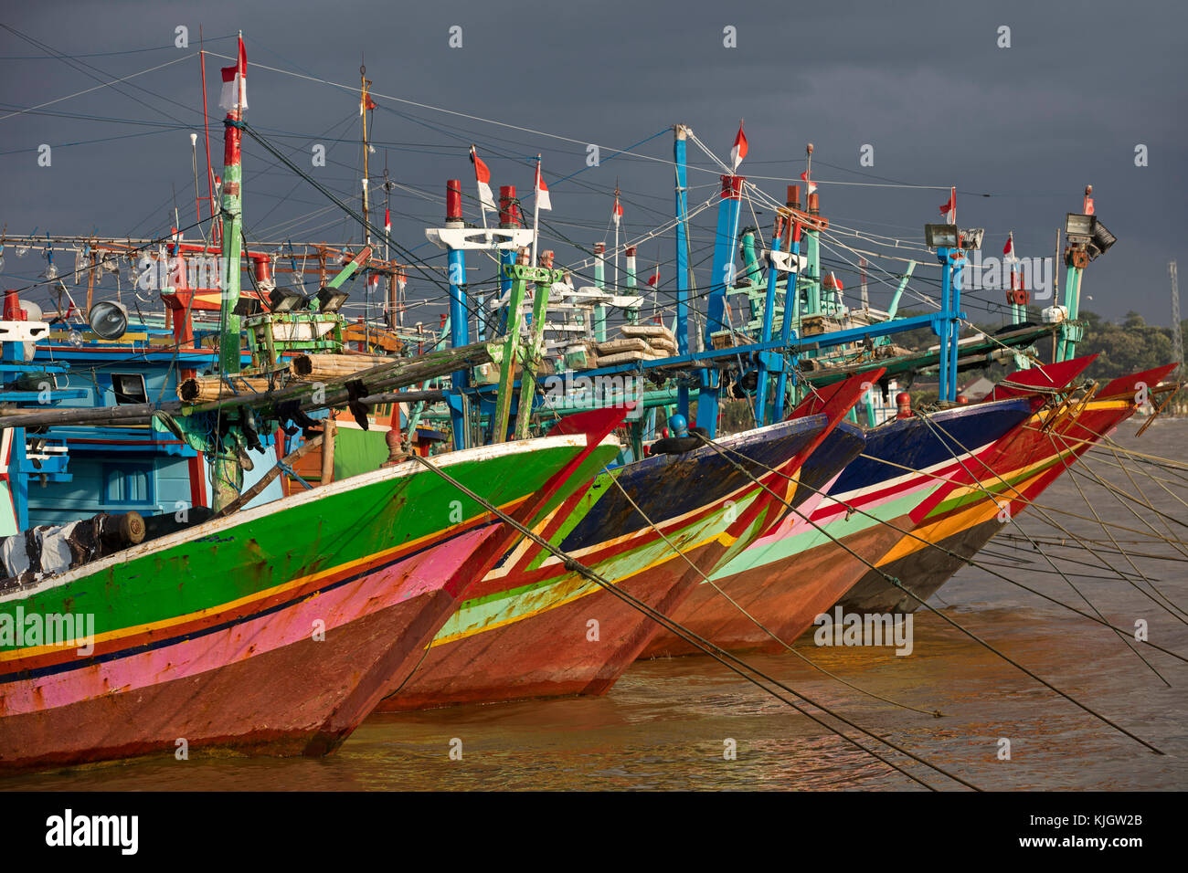 Colourful traditional Indonesian fishing boats in the port at Jepara, Central Java, Indonesia - Stock Image