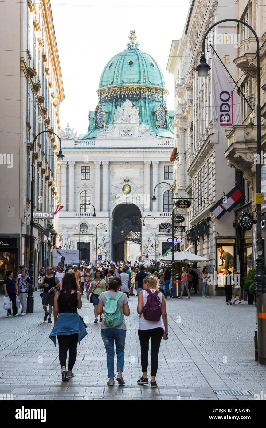 VIENNA, AUSTRIA - AUGUST 28: Tourists in the pedestrian area approaching the imperial Hofburg palace in Vienna, - Stock Image