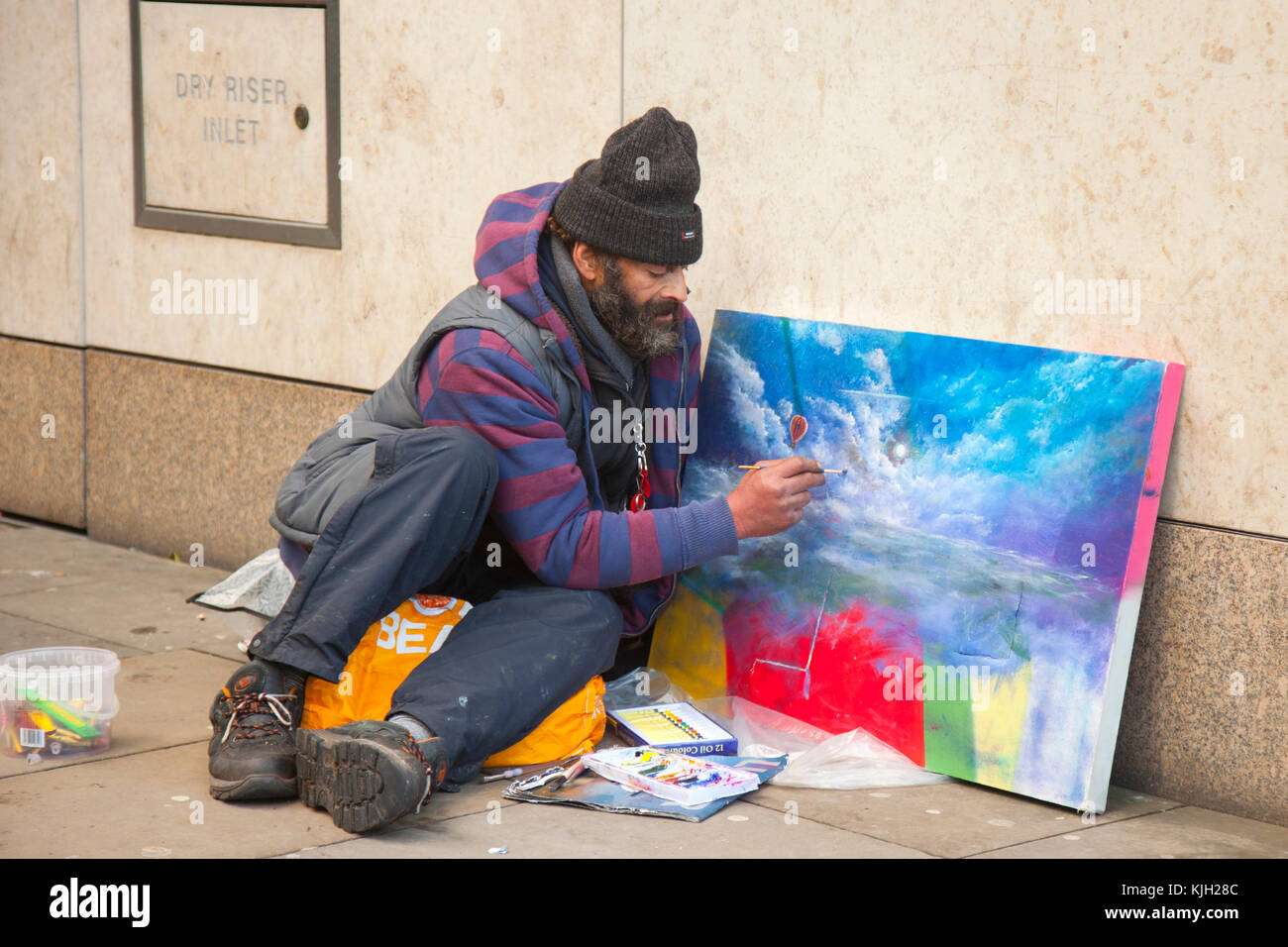 Manchester, UK. 24th Nov, 2017. Homeless man, a street artist in the city centre on Black Friday which has become Stock Photo