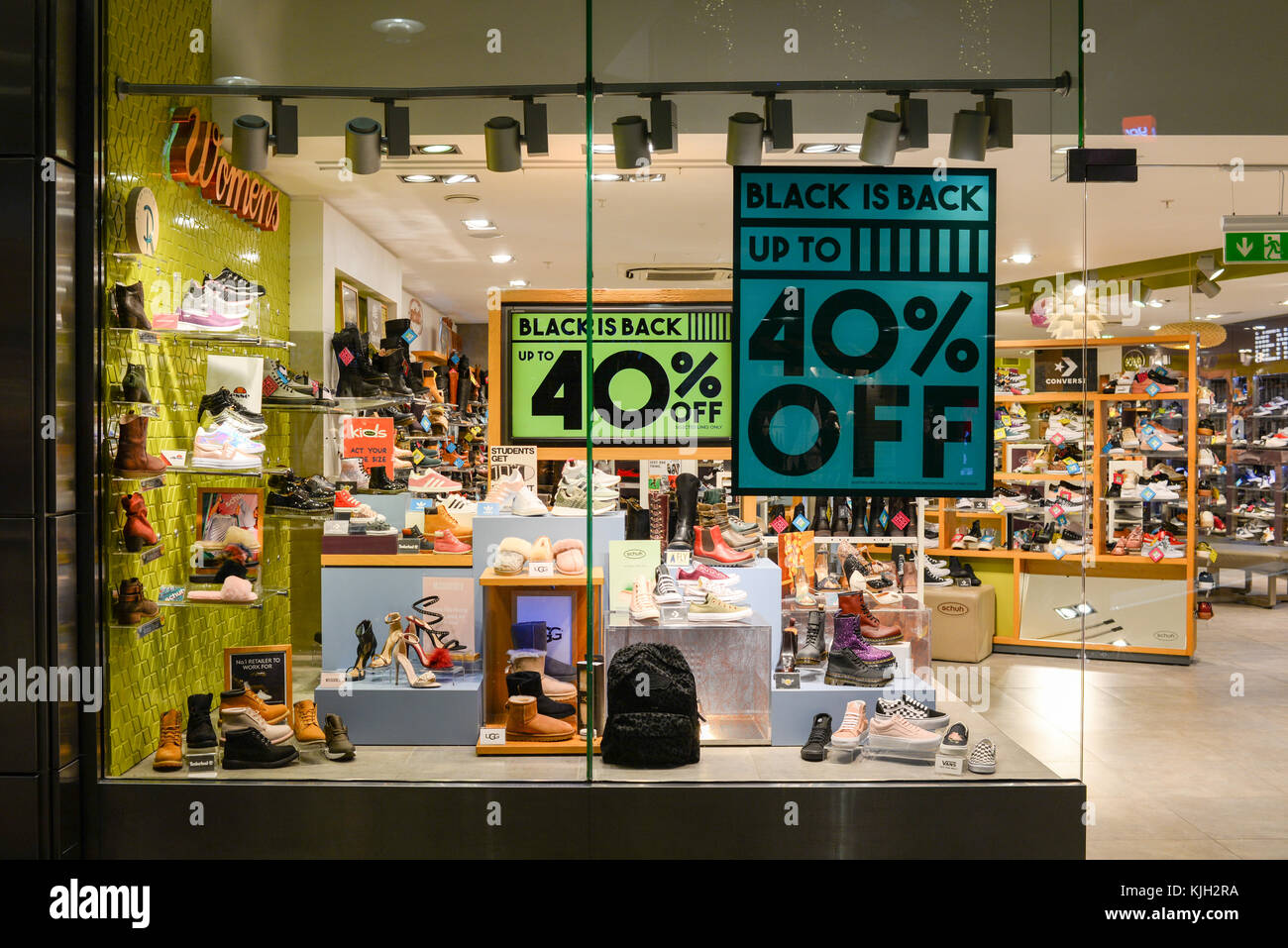 Black Friday sale signs in the windows of shoe retailer Schuh, Westquay shopping centre, Southampton, Hampshire, Stock Photo