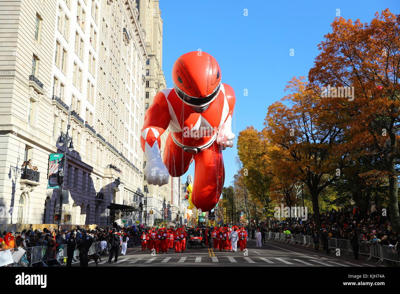 New York, USA. 23rd Nov, 2017. The Red Mighty Morphin Power Ranger balloon is led down Central Park West in the - Stock Image