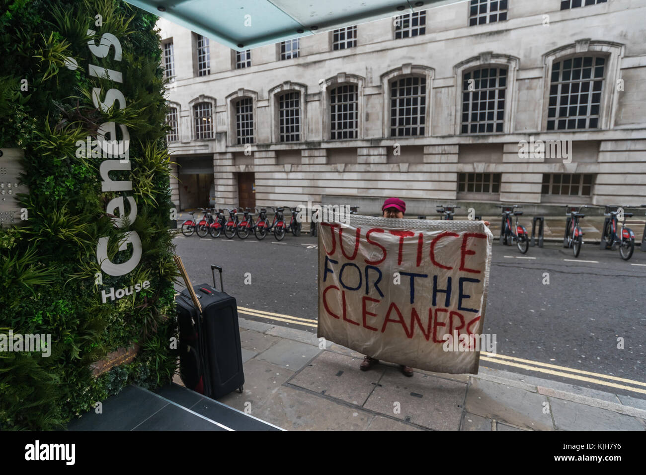 November 24, 2017 - London, UK. 24th November 2017. Victimised cleaner Beatriz Acuna holds a banner 'Justice For the Cleaners outside 138 Fetter Lane, one of the offices where she worked for Regular Cleaning Limited, a family business based in Lewisham., The Cleaners and Allied Independent Workers Union (CAIWU) was protesting on her behalf as she has been sacked by Regular without cause because of her trade union activities as a rep at One Finsbury Circus where she had worked for three years. The protesters at Fetter Lane were told there was nobody on site from either the management company. Stock Photo
