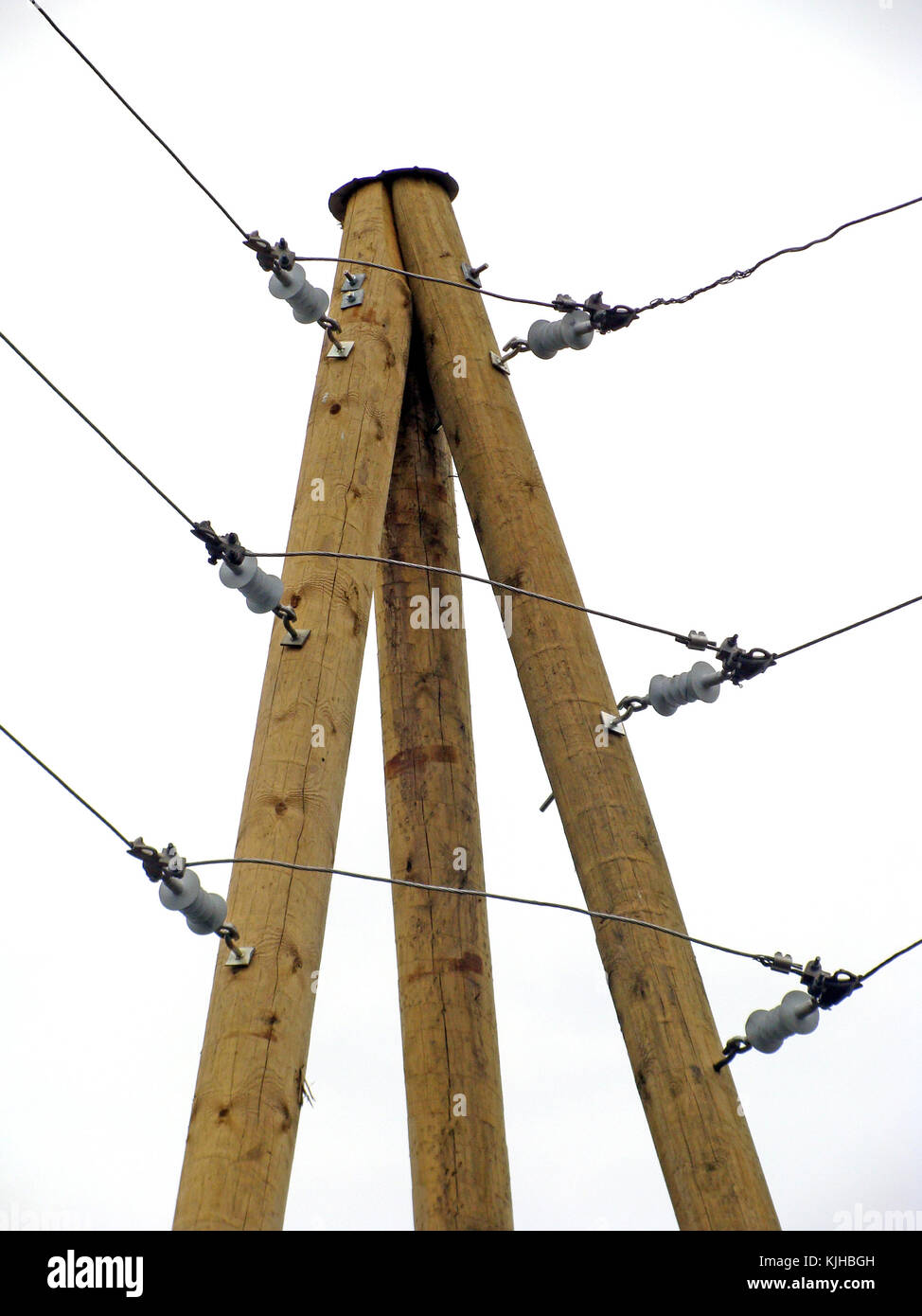 Modern Small Ceramic High Voltage Electric Insulators On Wooden Electrical Wiring Angle Pillar