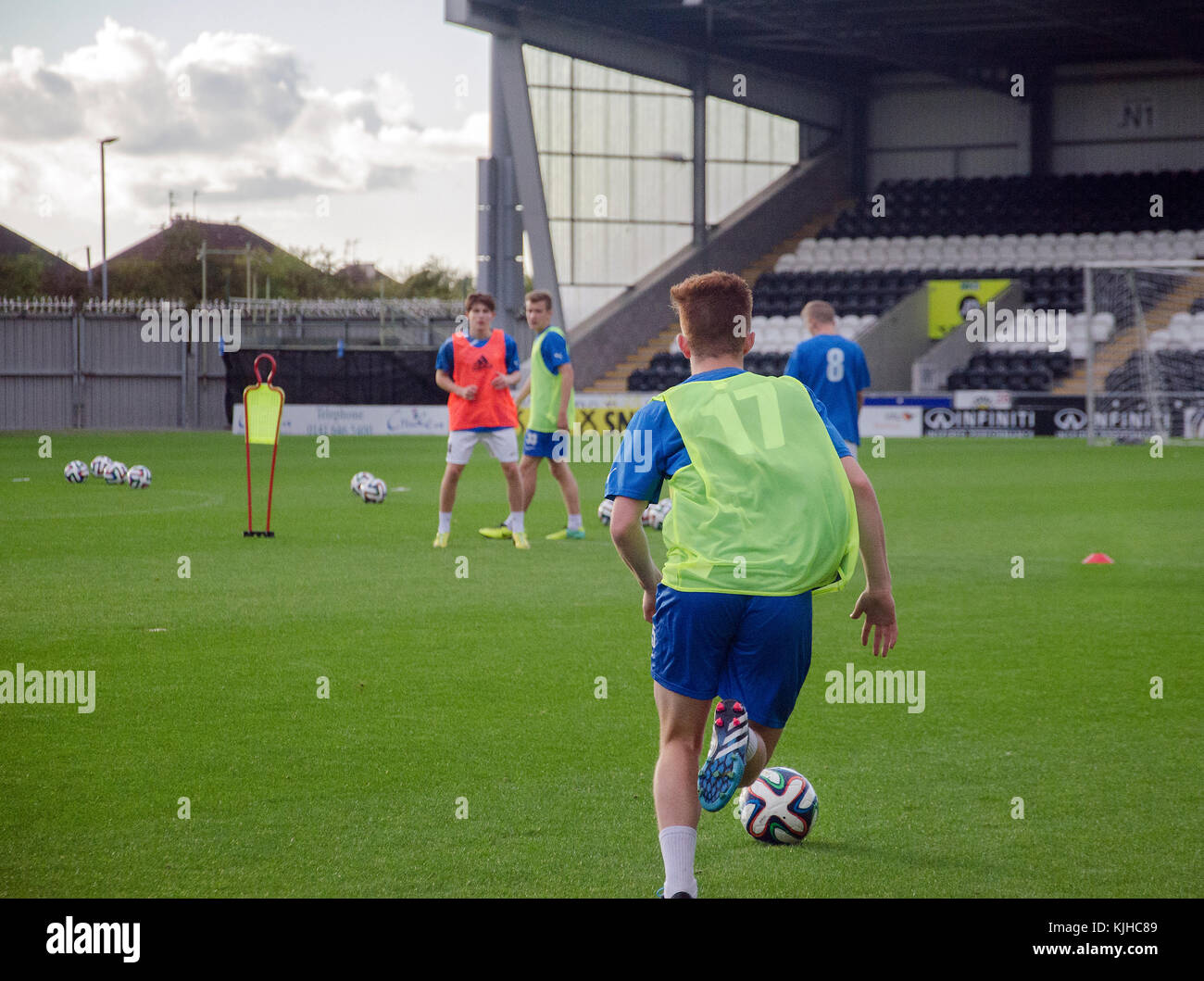 GLASGOW, Scotland, UK - SEPTEMBER 05 2014: A youth footballer taking part in a coaching session. - Stock Image