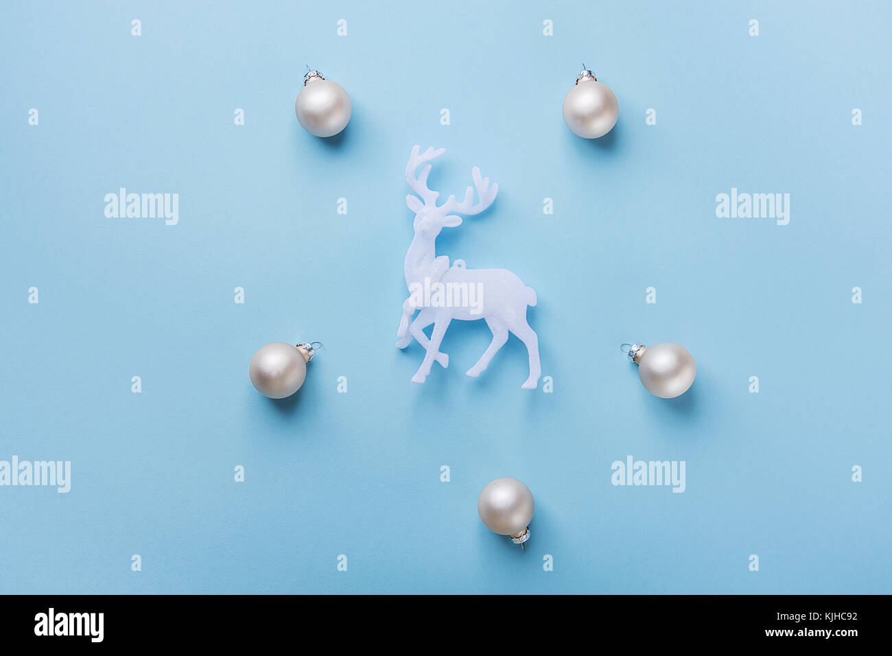 Elegant Christmas New Year Greeting Card Poster White Reindeer Silver Balls Pattern on Light Blue Background. Copy - Stock Image