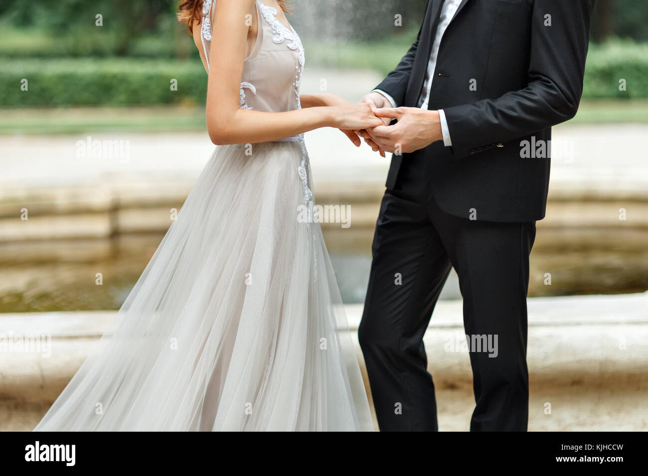 the hands of the newlyweds - Stock Image