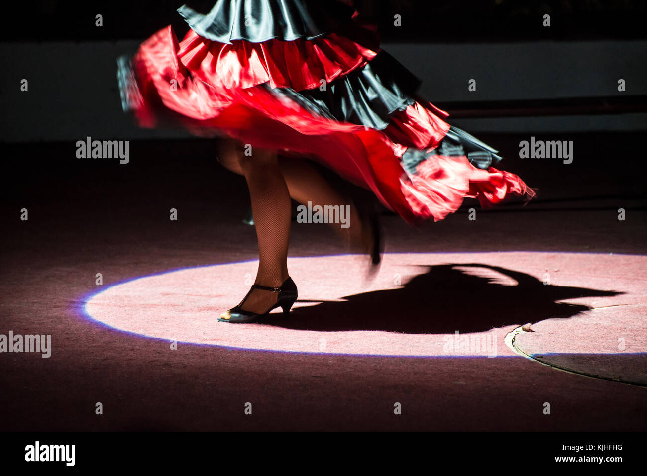 Dancing woman on the stage. Spanish dances - Stock Image