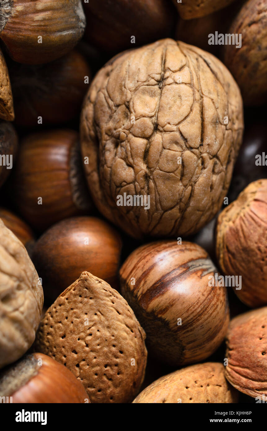 Overhead shot of whole, raw and unshelled mixed nuts selection. - Stock Image