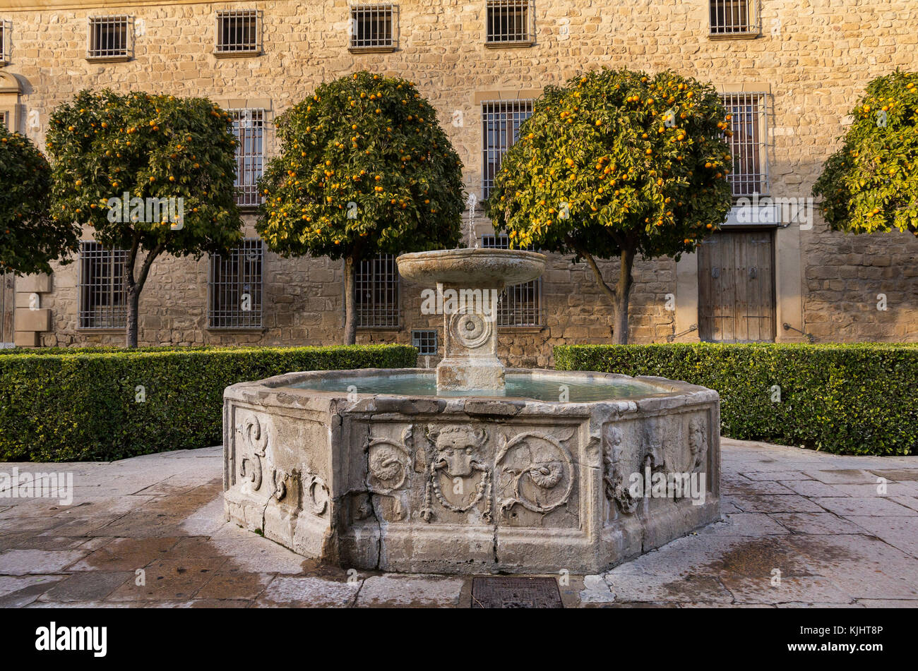 Fountain in a quiet square in Úbeda, Andalucía with a background of orange trees - Stock Image