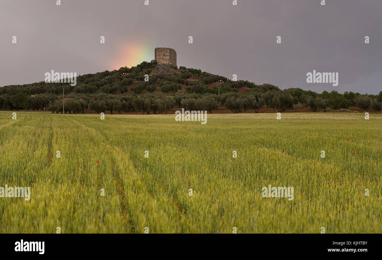 Raimbow behind the castle of Tower Tolanca in Sonseca (Toledo, Spain) - Stock Image