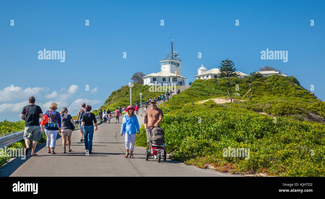 Australia, New South Wales, Newcastle, Nobby Head, visitors on their way to Nobby Lighthouse - Stock Image