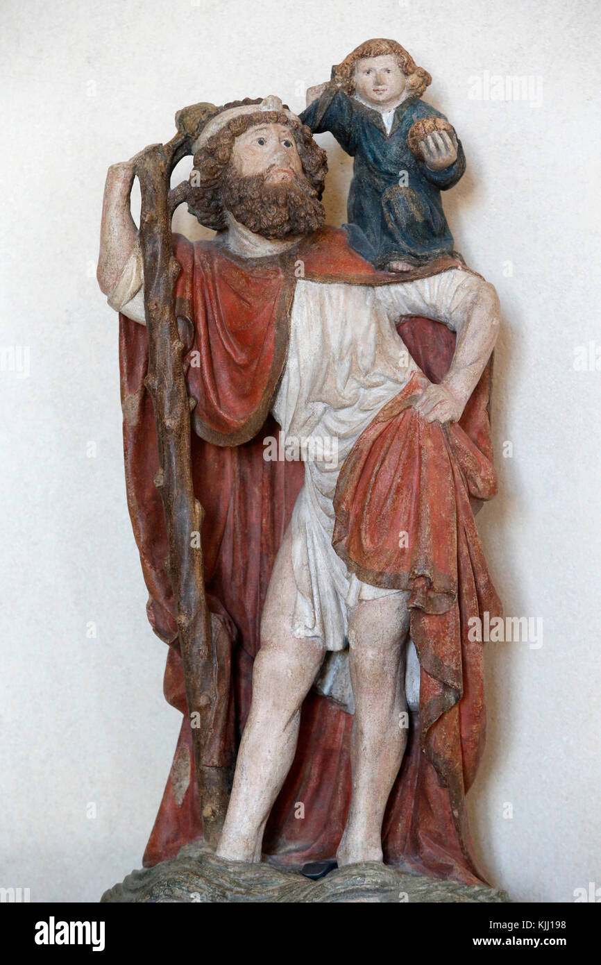 Louvre museum.  Saint Christopher. Polychrome stone. Possibly from Burgundy, 15th century. France. - Stock Image