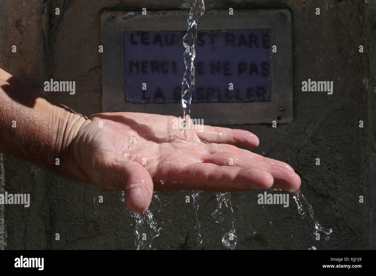 Hand in water fountain. Close-up.  France. - Stock Image