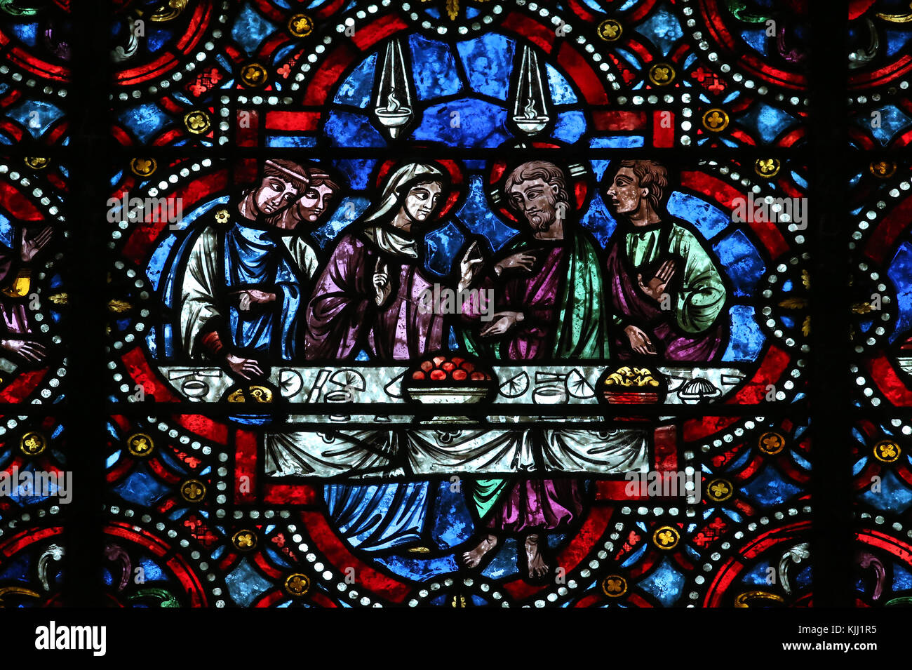Auxerre cathedral dedicated to Saint Stephan.  Stained glass window.  Marriage at Cana.  France. Stock Photo