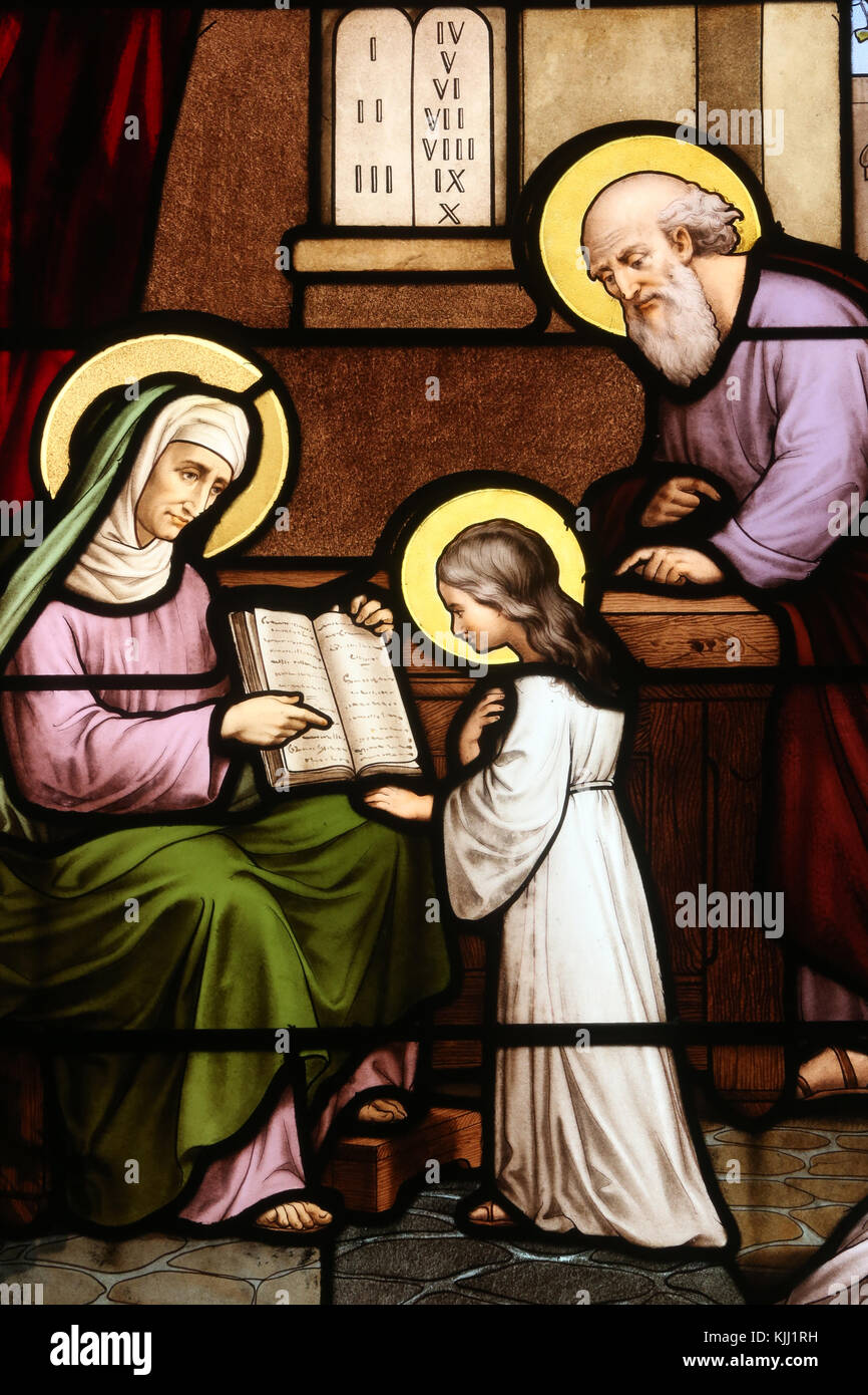 Saint Martin church.  Stained glass window. Saint Anne teaching Virgin Mary to read.  Avallon. France. Stock Photo
