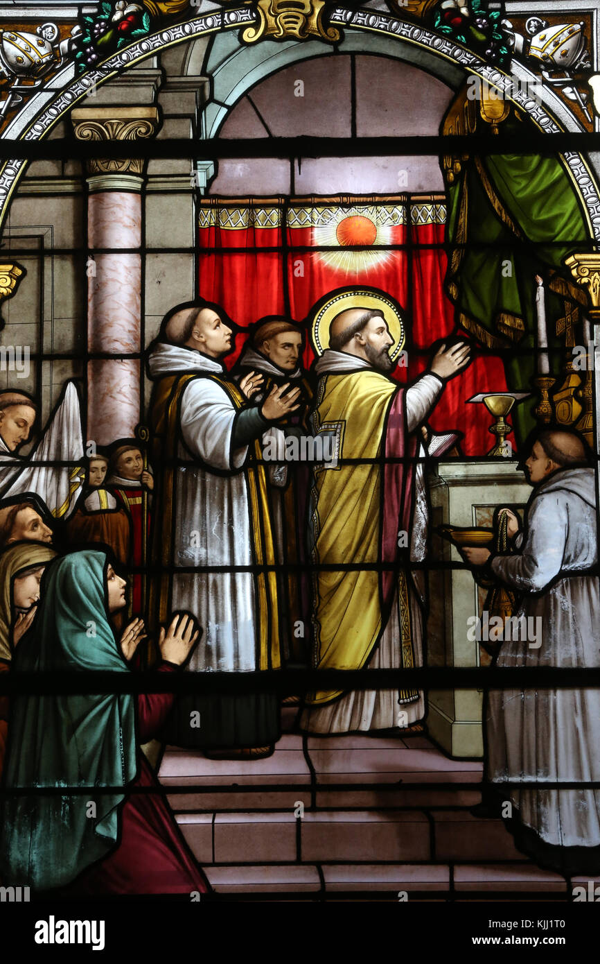 Saint Martin church.  Stained glass window.  Saint Martin of Tours.  Avallon. France. - Stock Image