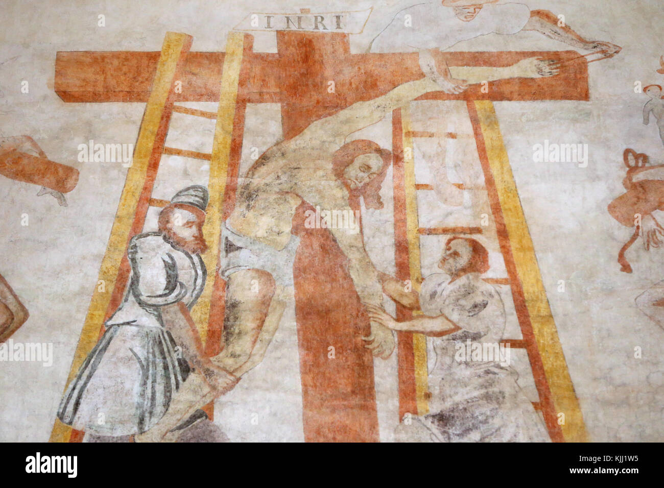 Vault de Lugny church.  16th century wall painting. Christ in his passion. Jesus is taken down from the cross.  - Stock Image