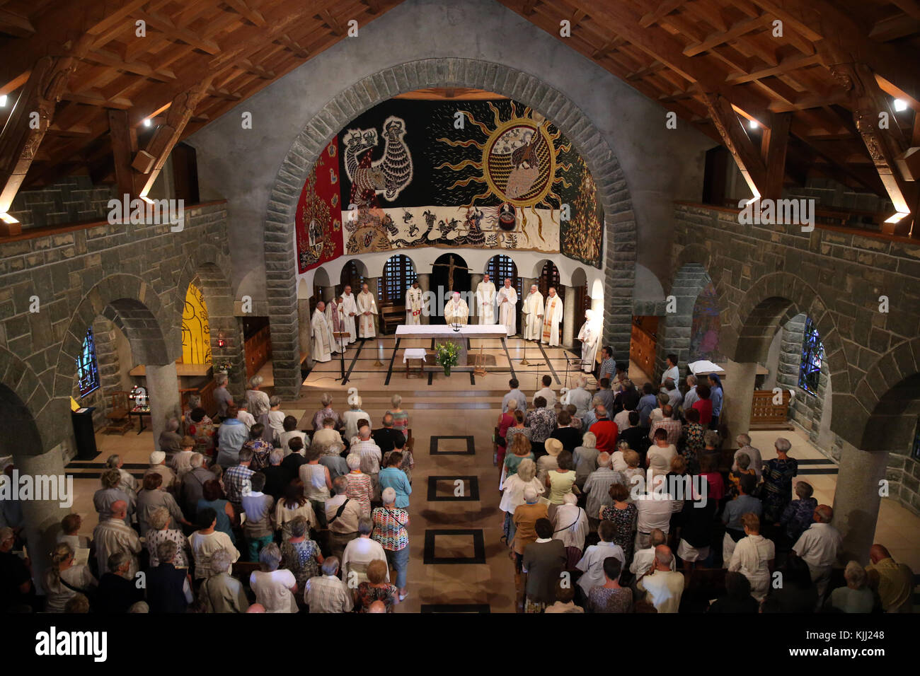Notre-Dame de Toute Grace du Plateau d'Assy (Our Lady Full of Grace of the Plateau d'Assy).  Catholic mass. - Stock Image