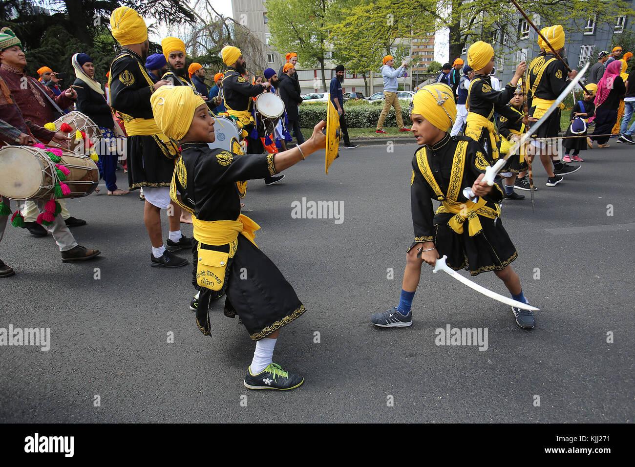 Sikhs celebrating Vaisakhi festival in Bobigny, France. Martial arts. - Stock Image