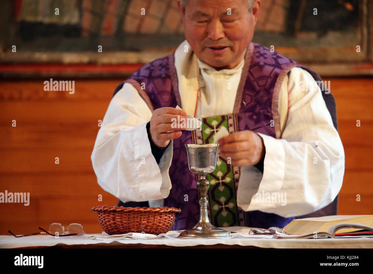 Catholic mass celebrated by Fr Kim En Joong.  France. - Stock Image