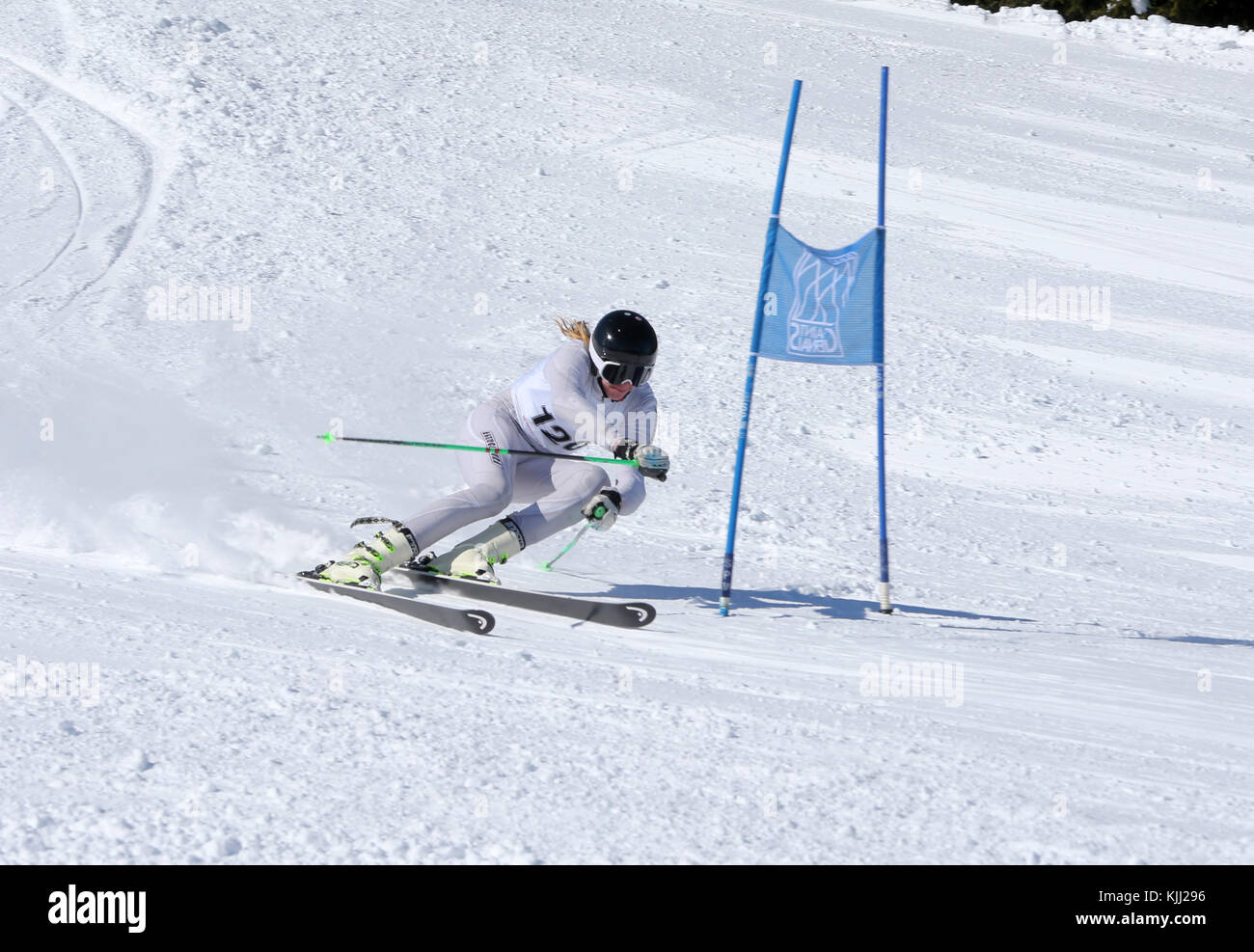 French Alps.  Giant Slalom skier rounds gate at high speed.  France. - Stock Image