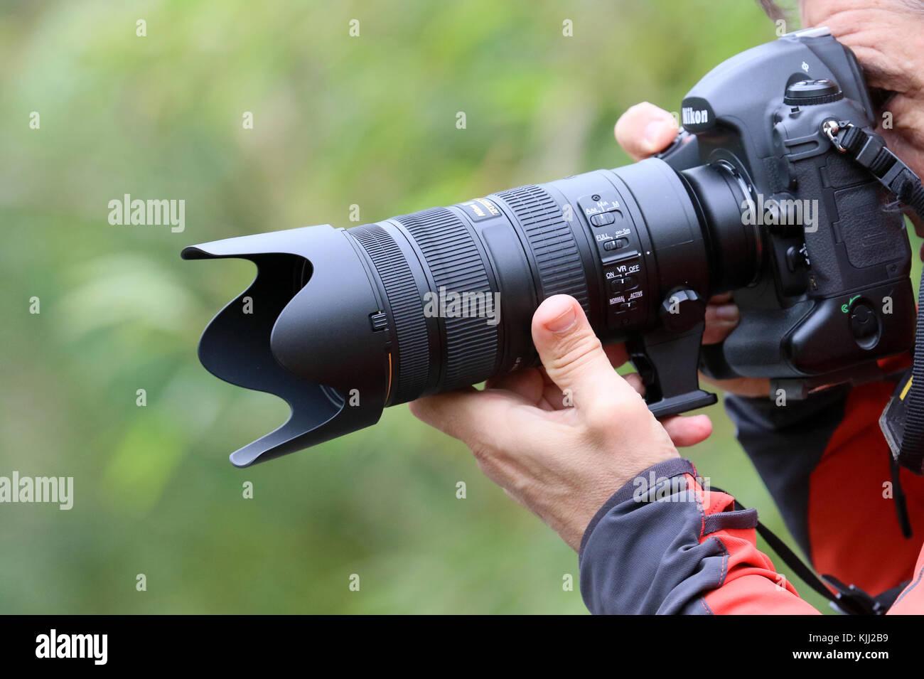 Photographer using a digital camera.  France. - Stock Image