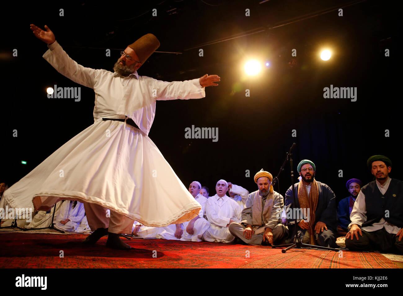 Mawlid (Prophet Muhammad's birthday) celebration in Paris, France. Whirling dervish. - Stock Image