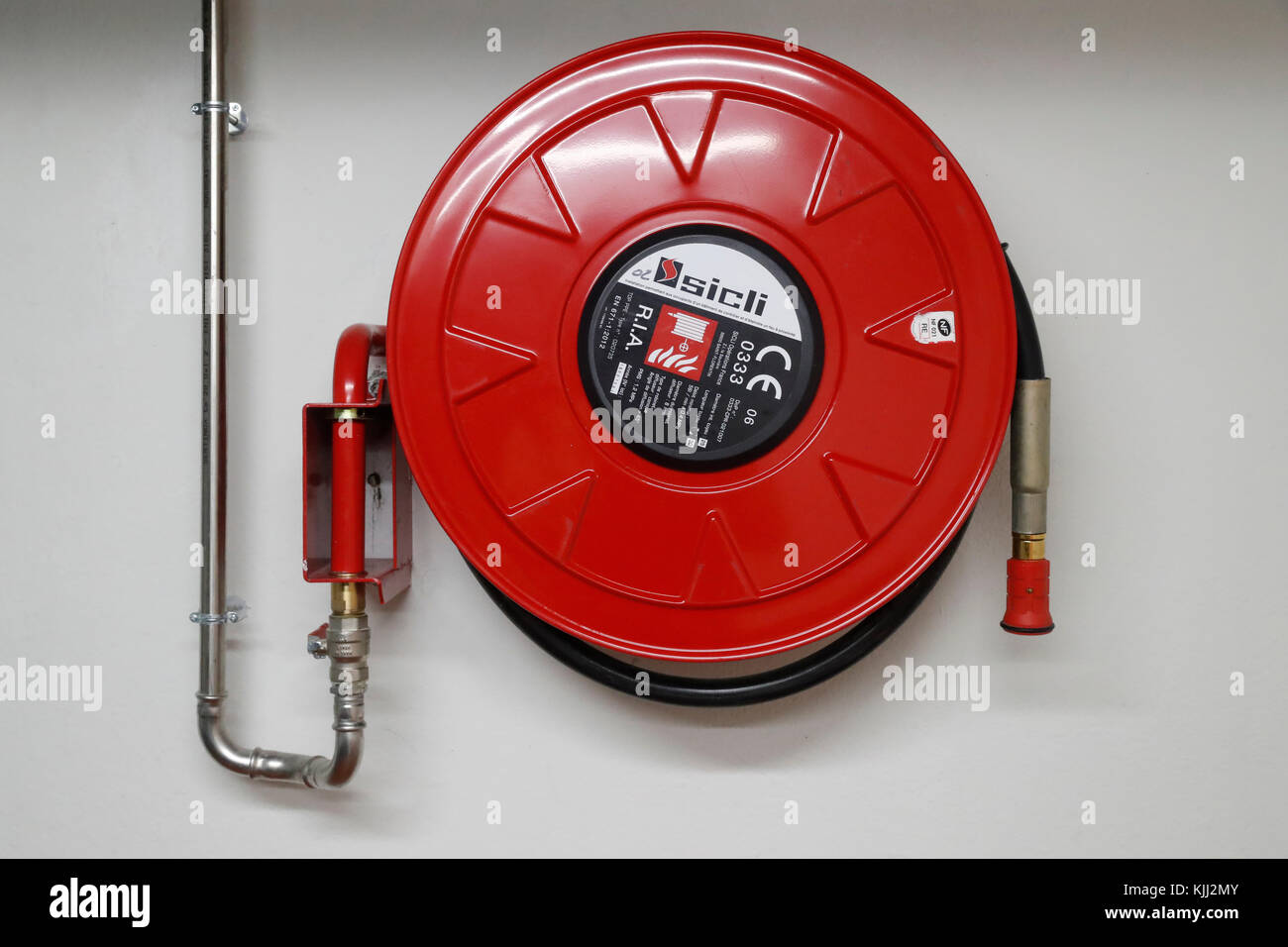 Fire Hose Attached To Pipeline In Hotel.  France. - Stock Image