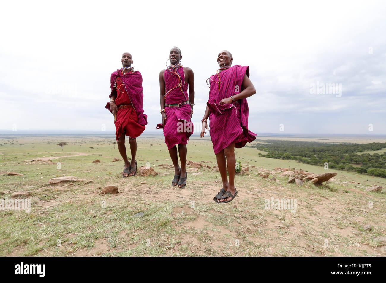 Masai warriors doing the traditional jump dance.  Masai Mara game reserve. Kenya. Stock Photo