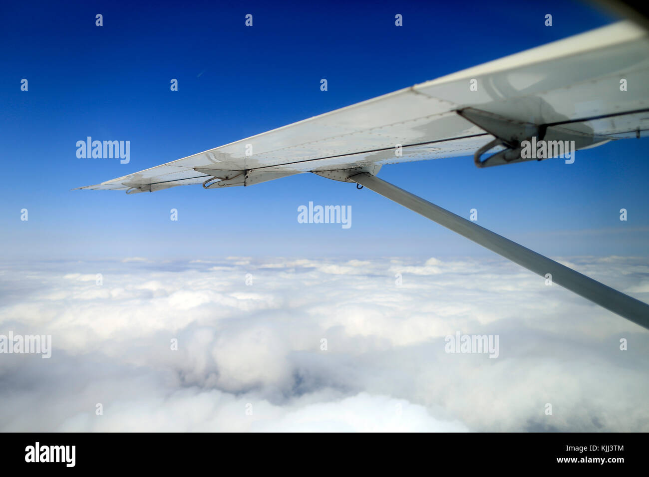 Clouds and blue sky from airplane window.  Masai Mara game reserve. Kenya. - Stock Image