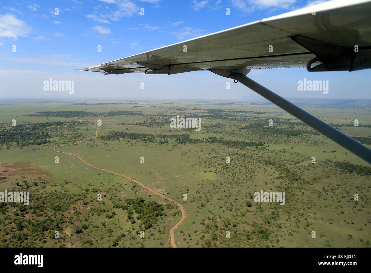 African savanna from airplane window.  Masai Mara game reserve. Kenya. - Stock Image