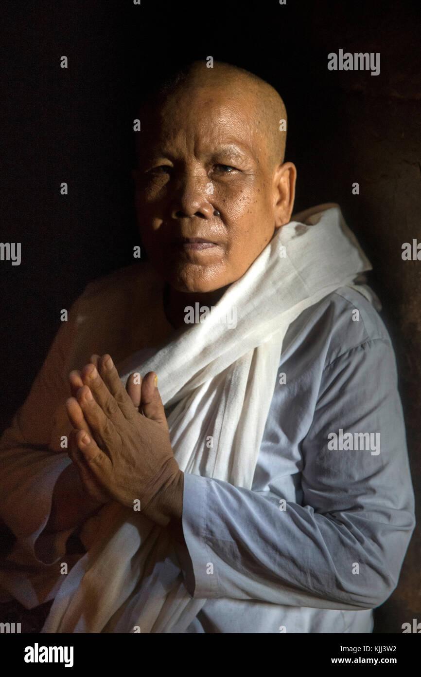 Buddhist nun in Angkor. Cambodia. - Stock Image