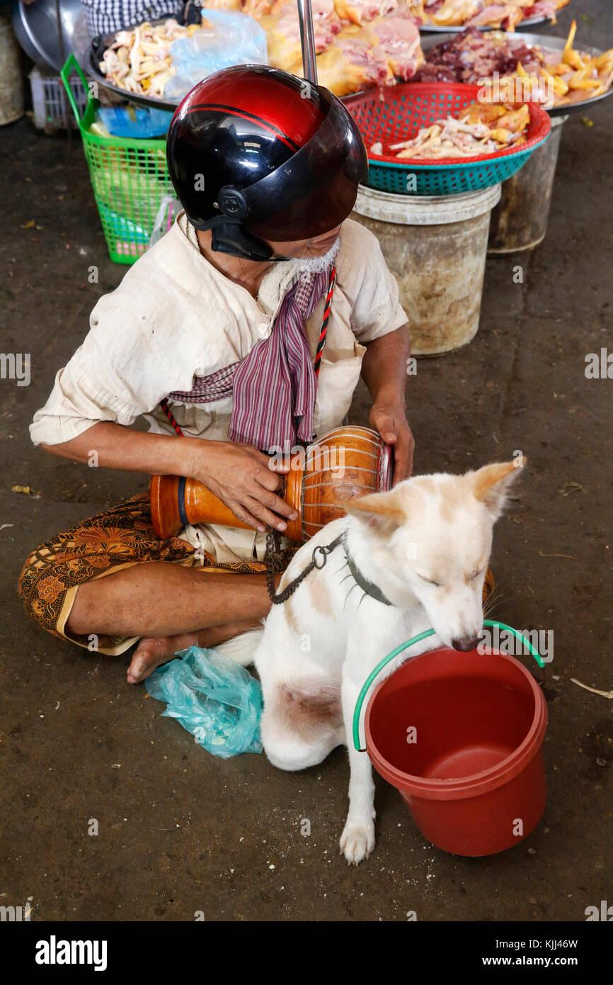 Bling beggar sitting at a Battambang market. Cambodia. - Stock Image