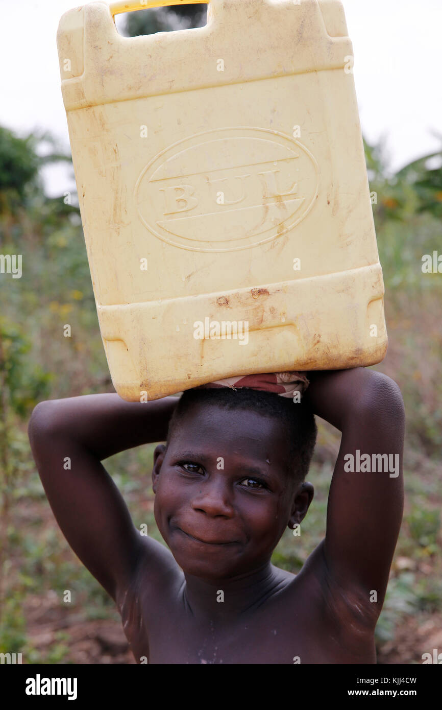 Ugandan child fetching water. Uganda - Stock Image