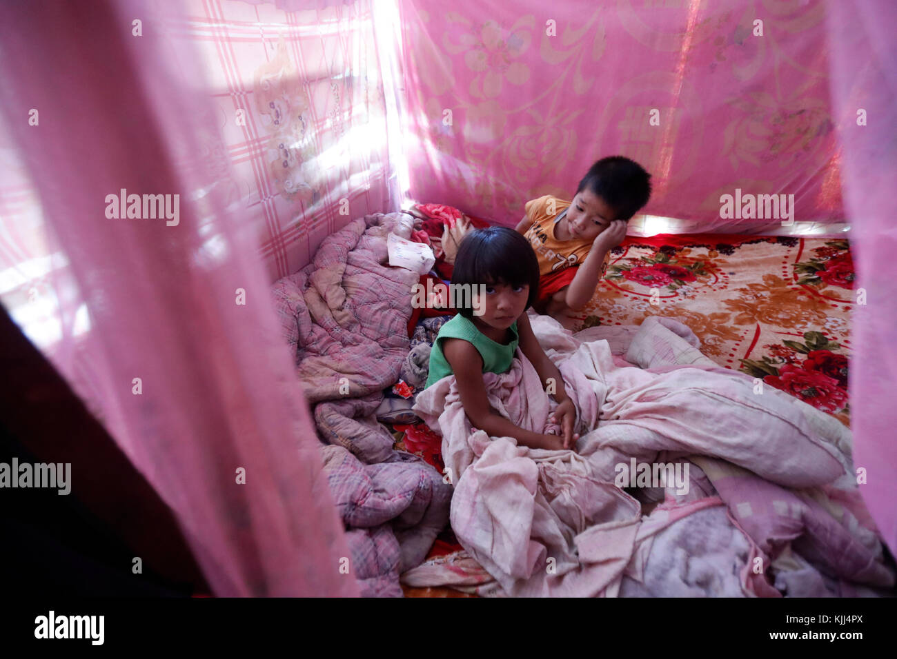 Mosquito net in a vietnamese house. - Stock Image
