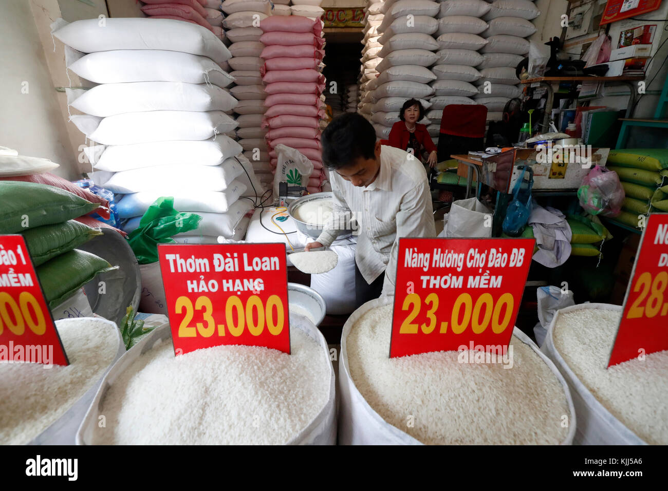 Price of white rice per kilogram in Vietnam Dong. Ho Chi Minh City. Vietnam. Stock Photo