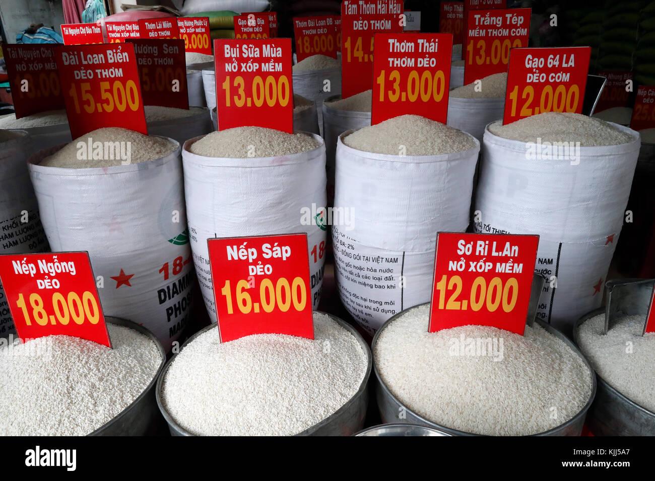 Price of white rice per kilogram in Vietnam Dong. Ho Chi Minh City. Vietnam. - Stock Image