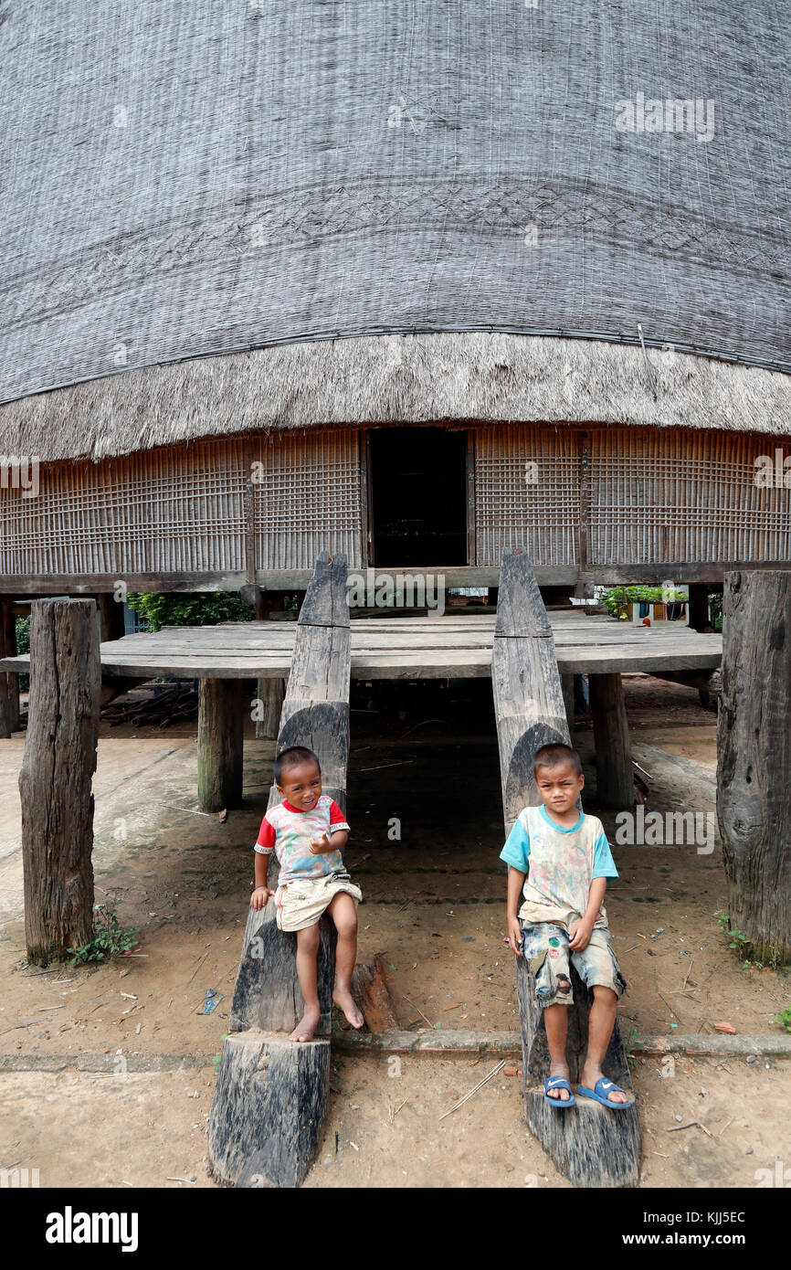 Bahnar ethnic minority people's communal Rong house. Two young boys. Kon Tum. Vietnam. - Stock Image