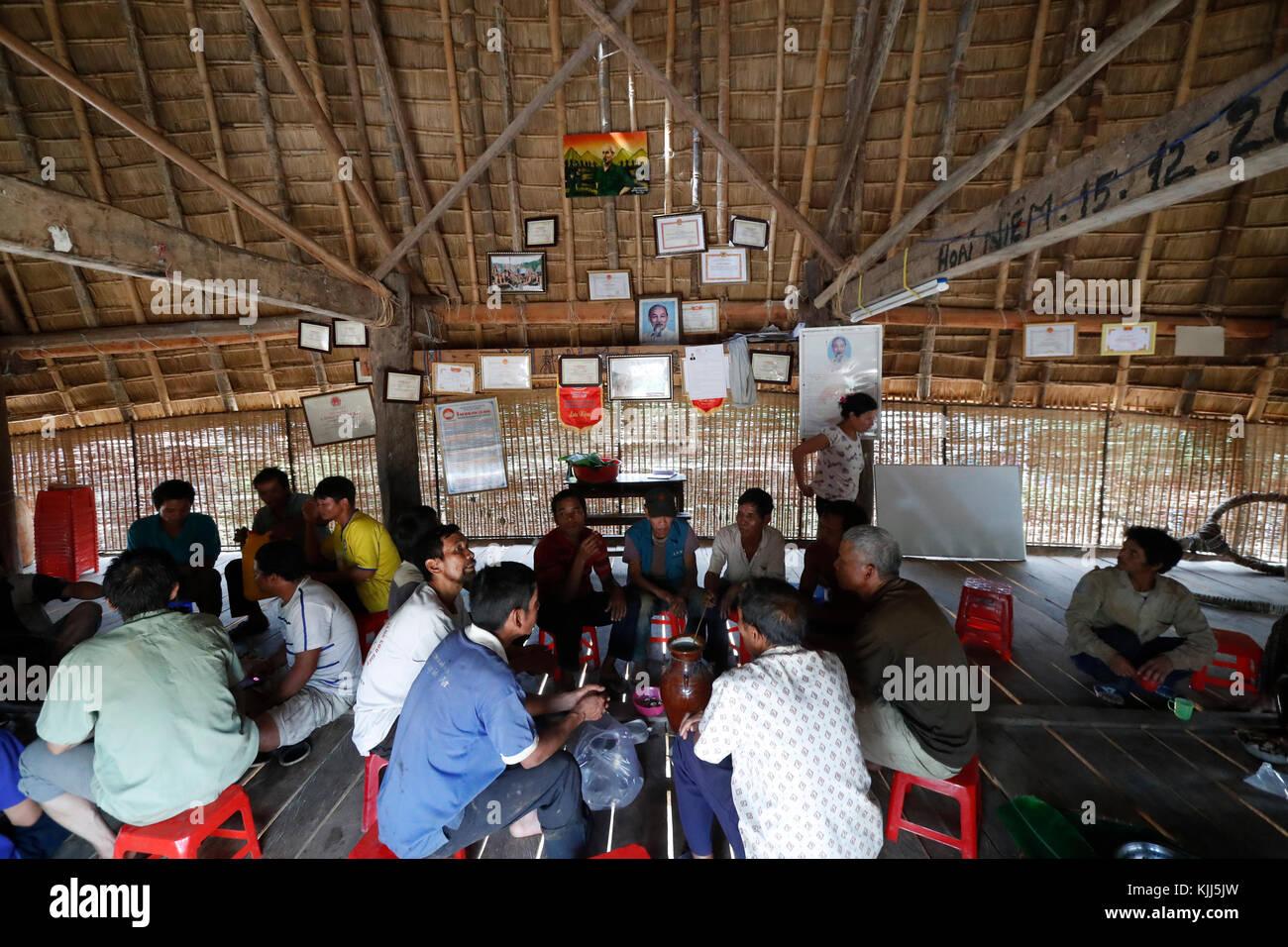 Bahnar ethnic minority people's communal Rong house. Village meeting.  Kon Tum. Vietnam. - Stock Image