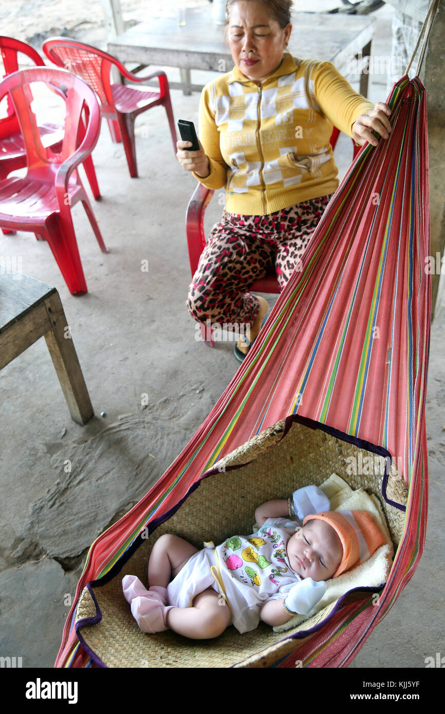 Mother with baby sleeping in Hammock.  Thay Ninh. Vietnam. - Stock Image