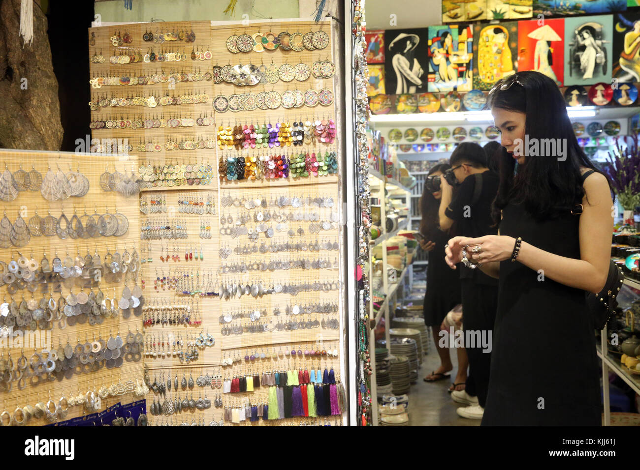 Young woman buying Woman hand made jeweller. Hoi An. Vietnam. - Stock Image