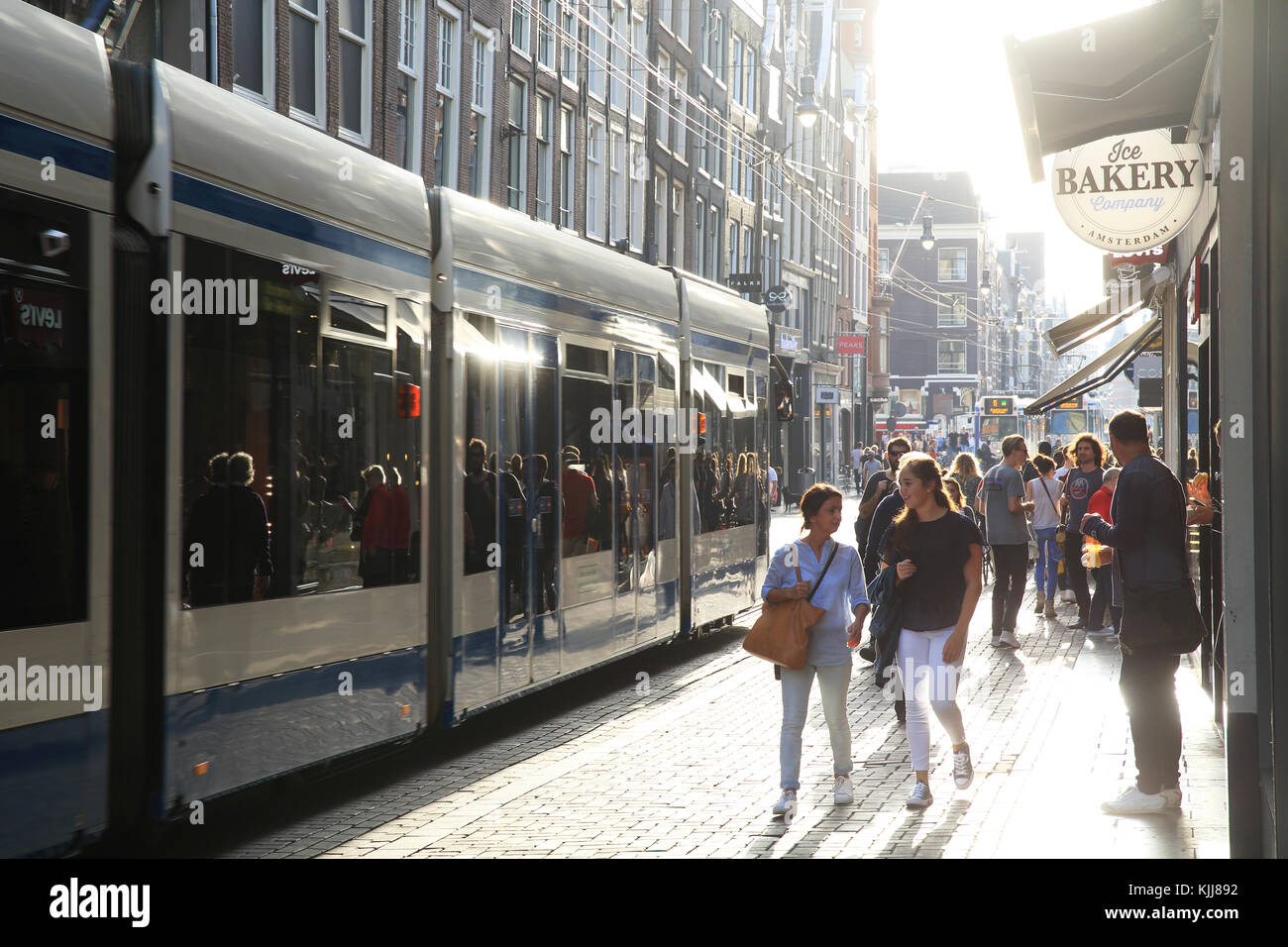 Autumn sunshine on the Leidsestraat, in Amsterdam, in the Netherlands - Stock Image