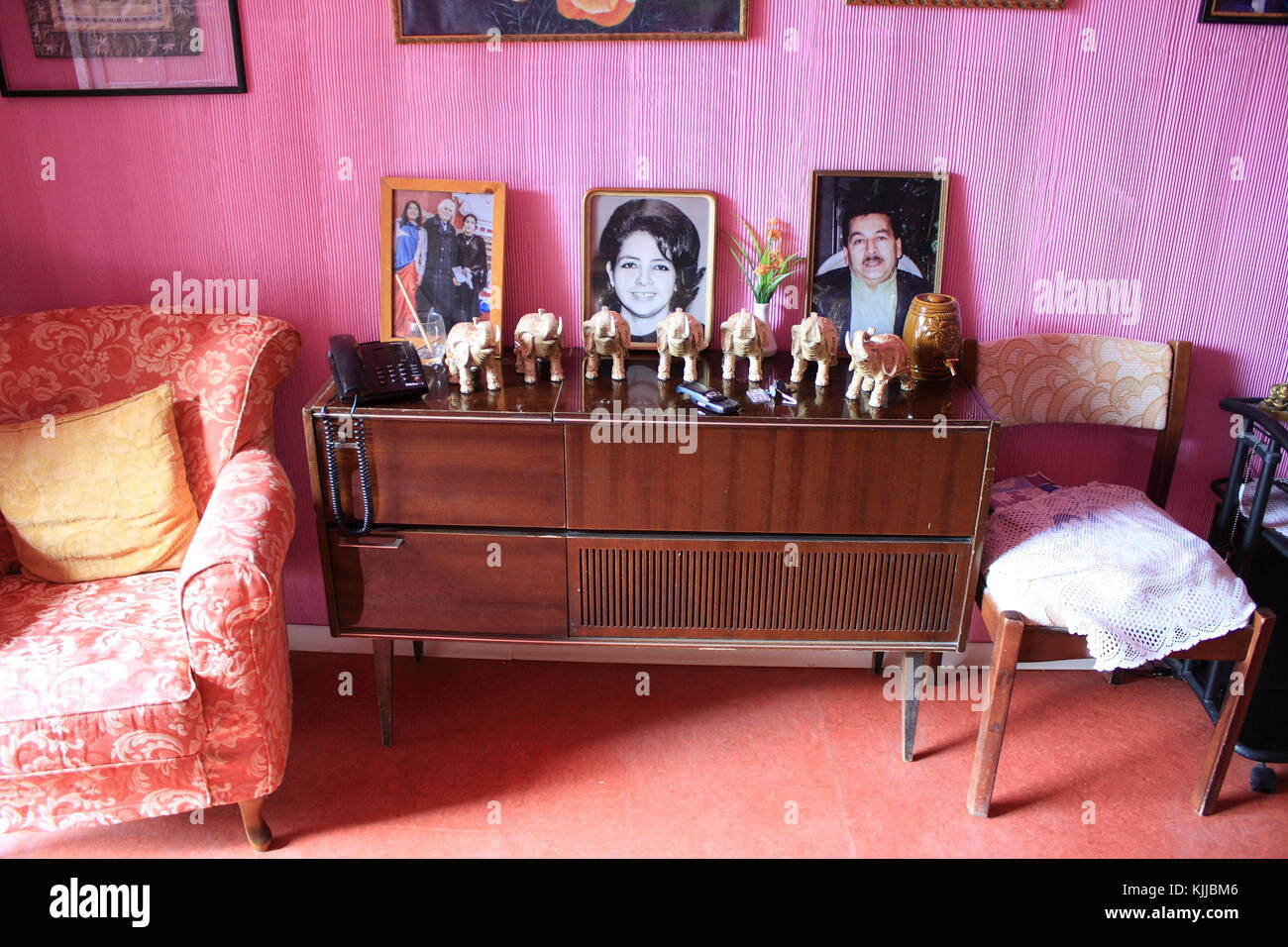 A Room Interior Of A Middle Class South American Family Pink Walls