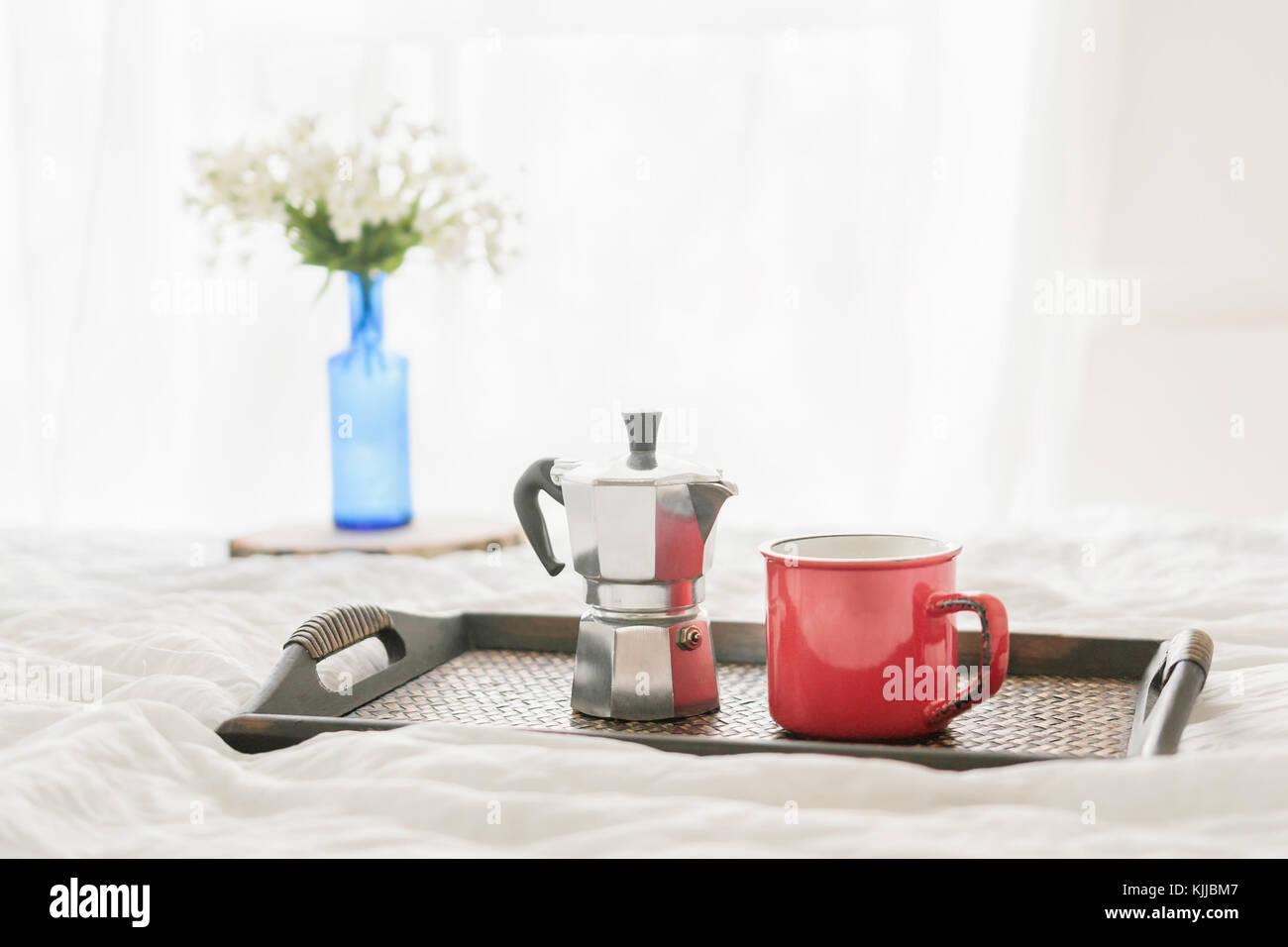 Coffee mug, steel coffee maker with white flowers in bottle in Stock ...