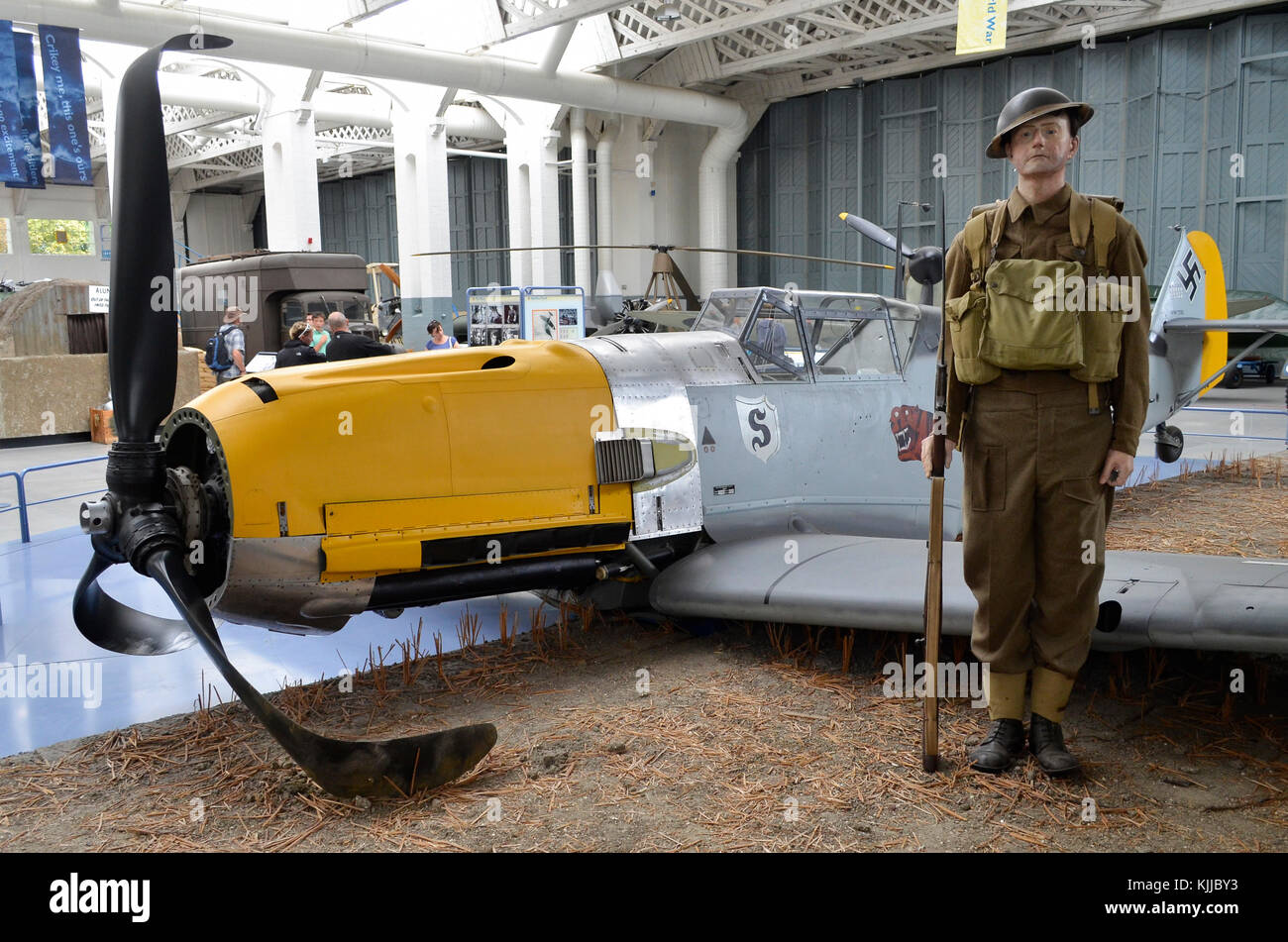 Messerschmitt Bf109E, Duxford IWM, UK, with British sentry recreating a Battle of Britain scene. This Bf109E was - Stock Image