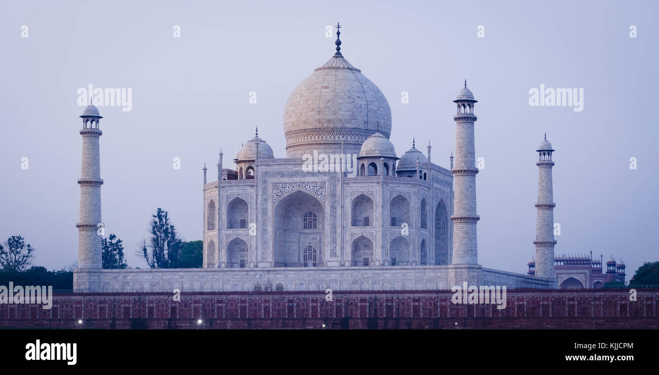 The Taj Mahal Mausoleum in Agra, India, seen from the other bank of the river, near the Garden of the Moon, at sunrise - Stock Image